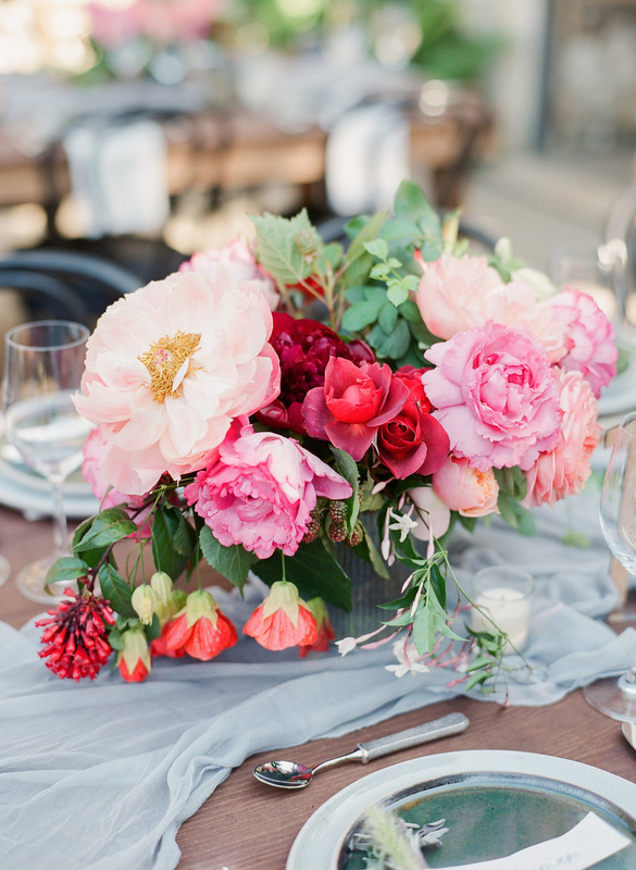 Floral arrangement by Flowerwild. Holman Ranch wedding by Rosemary Events.  Photo by Corbin Gurkin