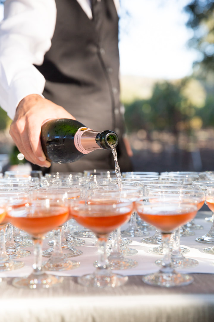 Time to pop the bubbly - Rosemary Events wedding Napa Valley Estate. Photo by Kristen Loken