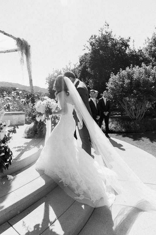 Wedding Couple approaching the Chuppah - Rosemary Events and Flowerwild. Photo by Corbin Gurkin