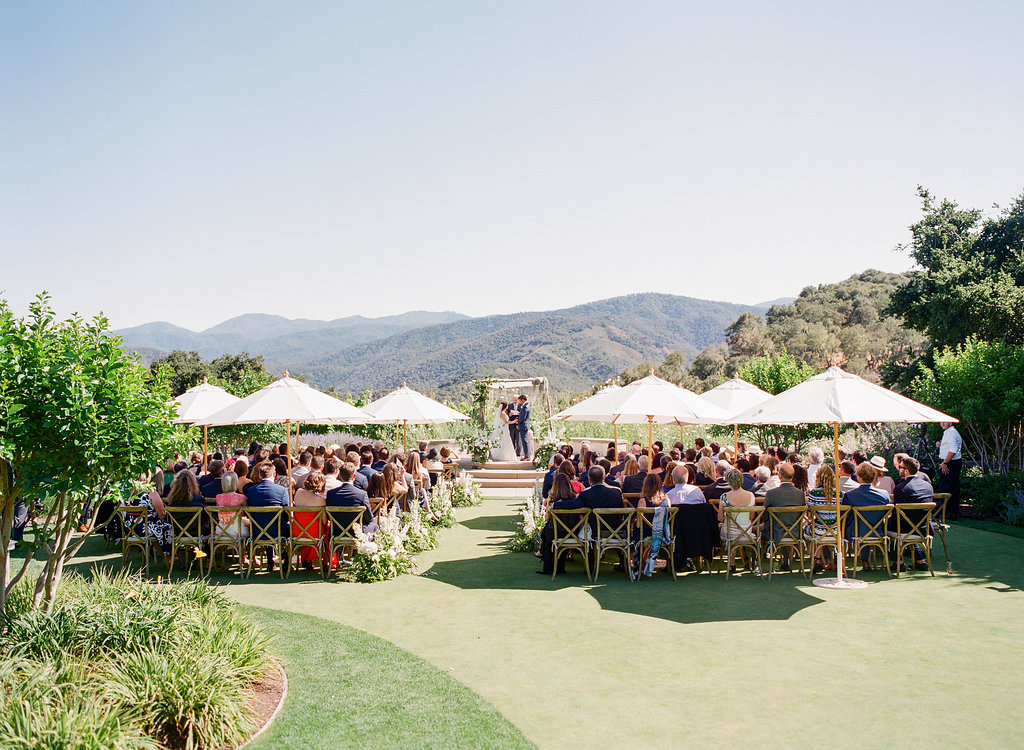 Wedding Ceremony at Holman Ranch. Rosemary Events and Flowerwild wedding - Holman Ranch  Photo by Corbin Gurkin