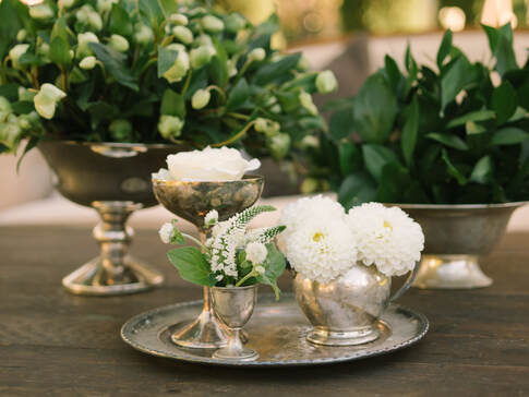 Hellebores & Silver - Coffee table arrangement at wedding by Rosemary Events and Sillapere.  Photo by Kristen Loken