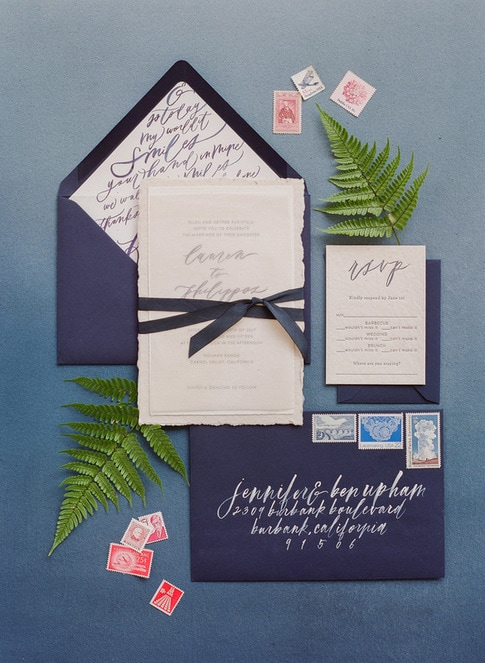 navy & white  invitation set with handtorn paper and ribbon finish by Tiny Pine Press - Wedding by Rosemary Events &  Flowerwild w/ lettering by Chelsea Pejata  Photo by Corbin Gurkin