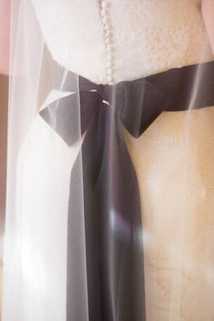 Vera Wang Bridal Gown with Black Bow. Photo by Isabel Lawrence.  Planner Rosemary Events