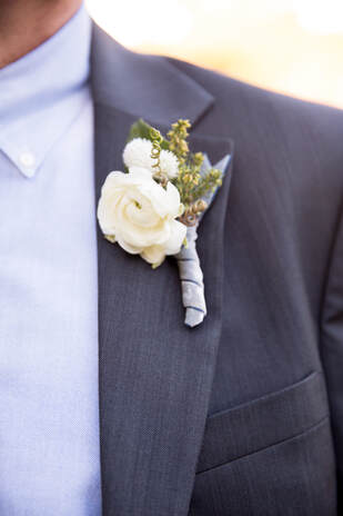 Boutonniere by Sillapere at Rosemary Events wedding. Photo by Isabel Lawrence